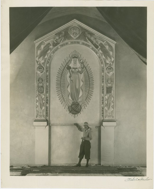 Lucile Lloyd standing in front of the altarpiece mural, Saint Mary of the Angels Church, Hollywood, Calif., 1932
